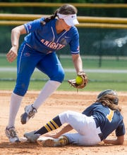 Tuscaloosa Academy's Ivy White is safe at sec on under the tag of Macon East's Madisyn Kennedy during the AISA State Softball Tournament at Lagoon Park in Montgomery, Ala., on Thursday May 2, 2019.
