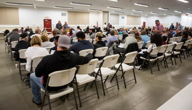Officials hold the commissioners deed sale on April 30 at the Delaware County fairgrounds. The sale saw buyers pick up 162 properties of the 321 that were listed for the sale.