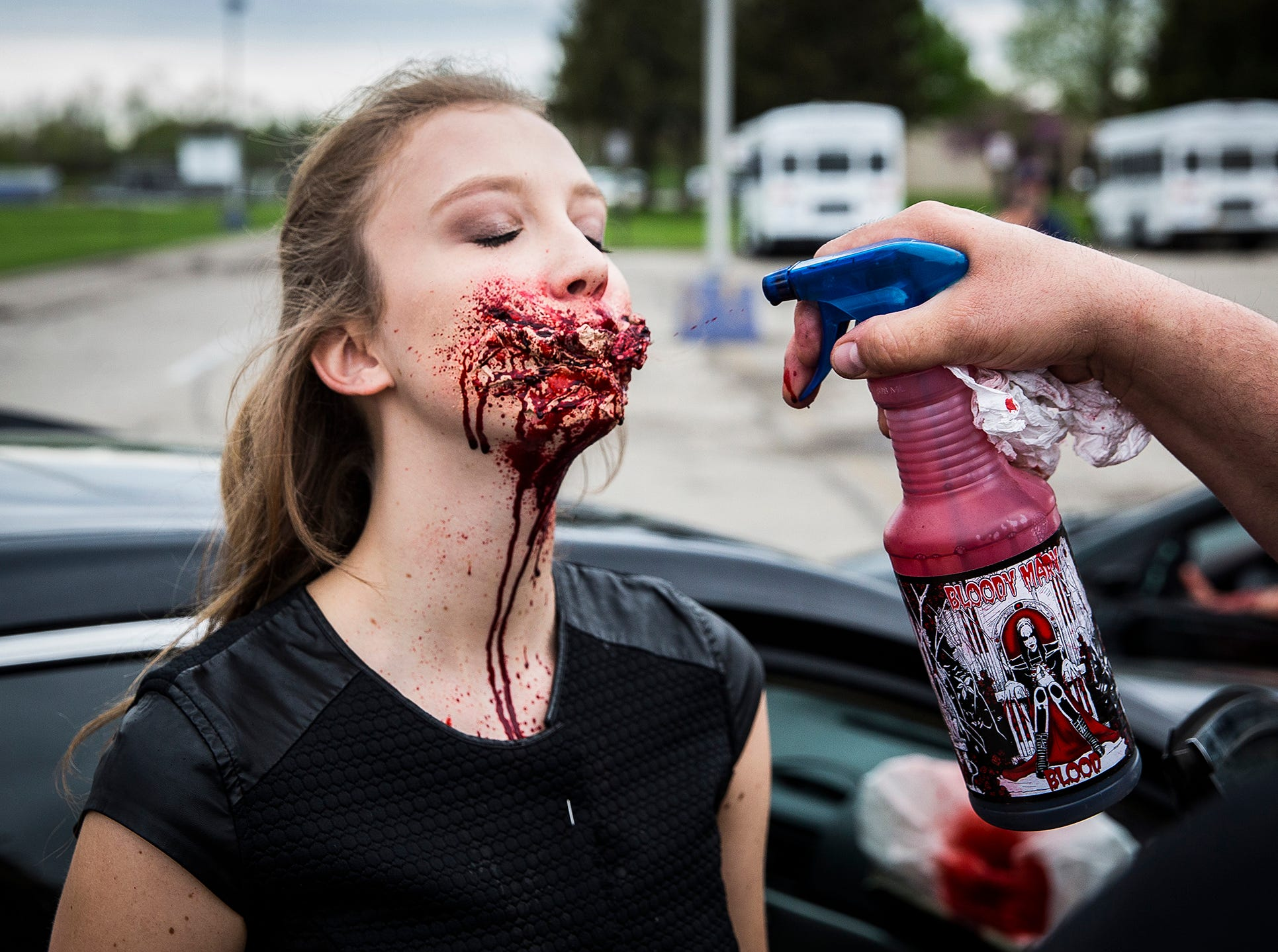 Claire Tinkle prepares to play the part of a crash victim during the 2019 Living Proof Crash Re-Enactment at Central Wednesday. The event seeks to raise awareness of the dangers of driving while intoxicated with re-enactments of crashes, court scenes and funerals. Makeup artist Brian Blair donated time and material for this year's Living Proof.