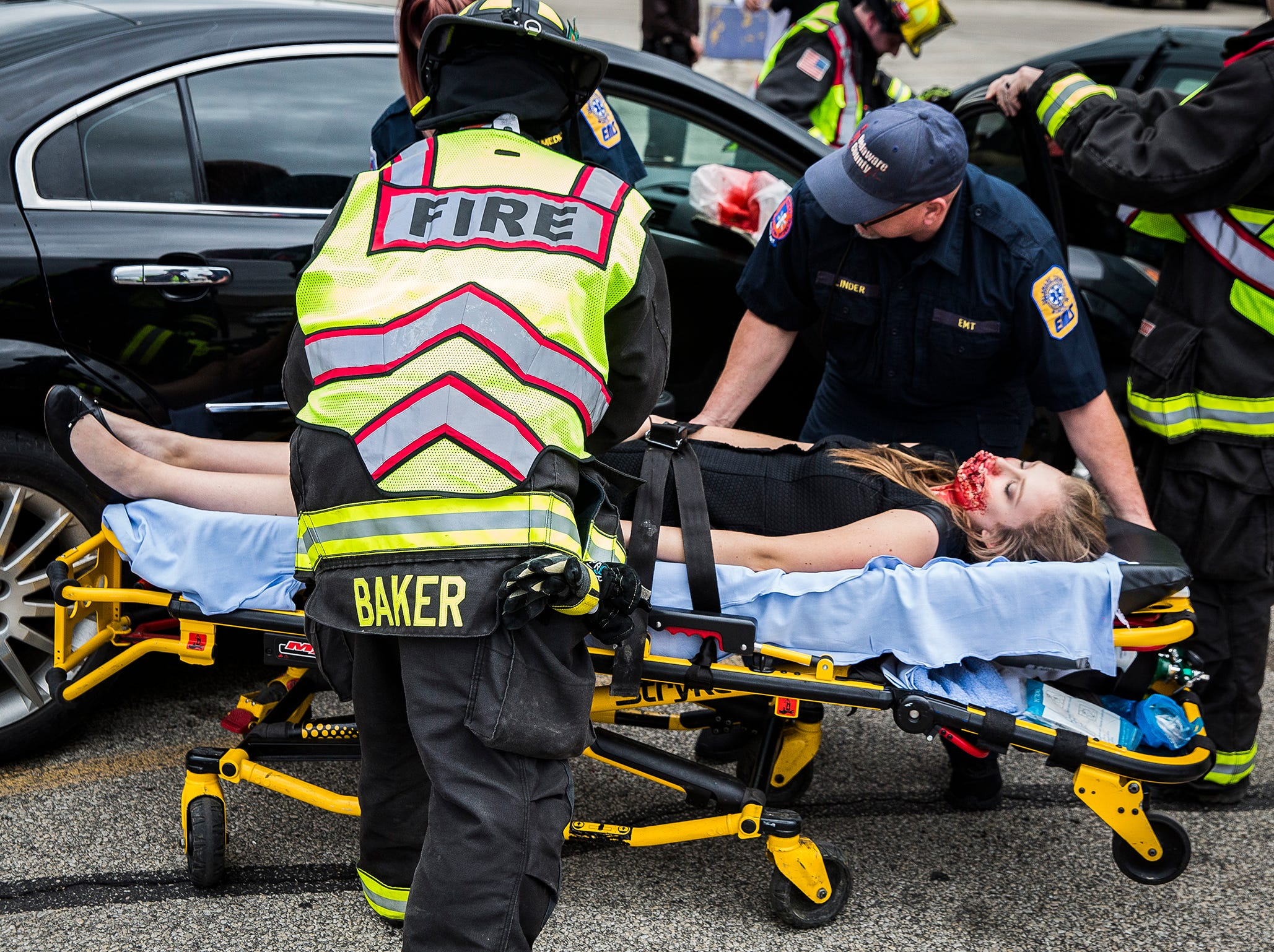 Volunteer, student actors worked with police and firefighters during the 2019 Living Proof Crash Re-Enactment at Central Wednesday. The event seeks to raise awareness of the dangers of driving while intoxicated with re-enactments of crashes, court scenes and funerals. Makeup artist Brian Blair donated time and material for this year's Living Proof.