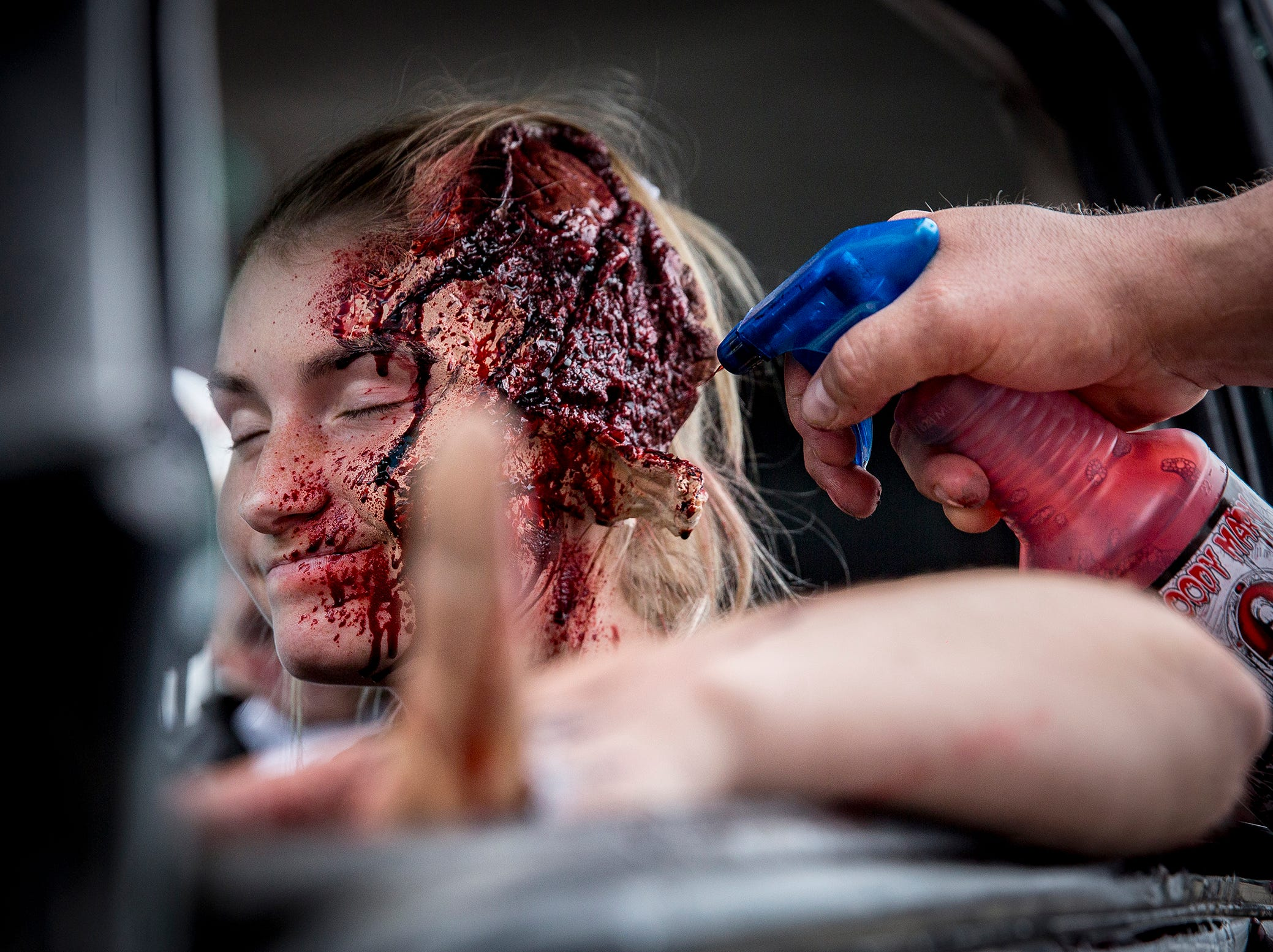 Volunteer actor Rylee Huffman has makeup and other effects applied before the first group of attendees arrived for the 2019 Living Proof Crash Re-Enactment at Central Wednesday. The event seeks to raise awareness of the dangers of driving while intoxicated with re-enactments of crashes, court scenes and funerals. Makeup artist Brian Blair donated time and material for this year's Living Proof.