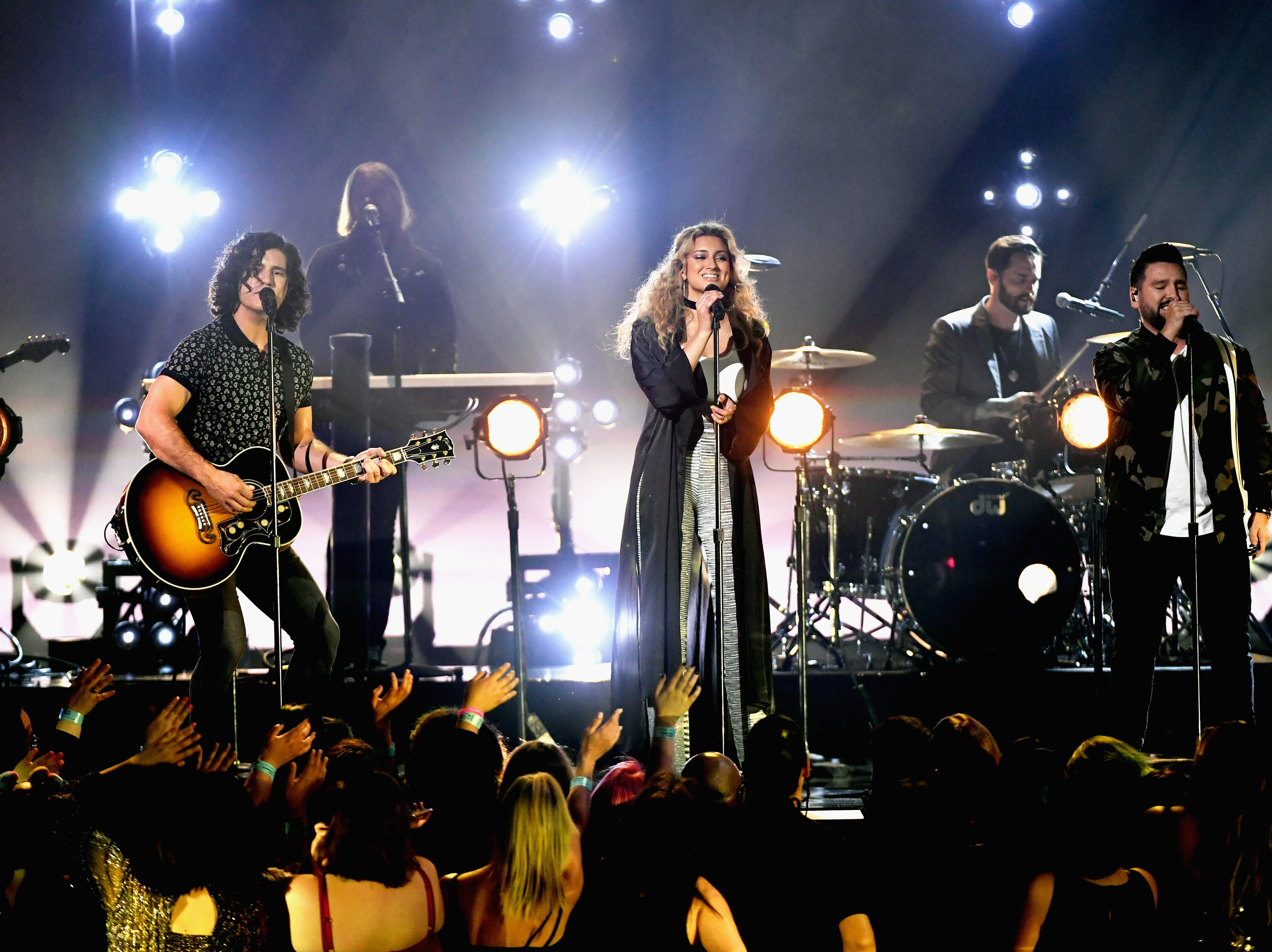 (L-R) Dan Smyers of Dan + Shay, Tori Kelly, and Shay Mooney of Dan + Shay perform onstage during the 2019 Billboard Music Awards at MGM Grand Garden Arena on May 1, 2019 in Las Vegas, Nevada.