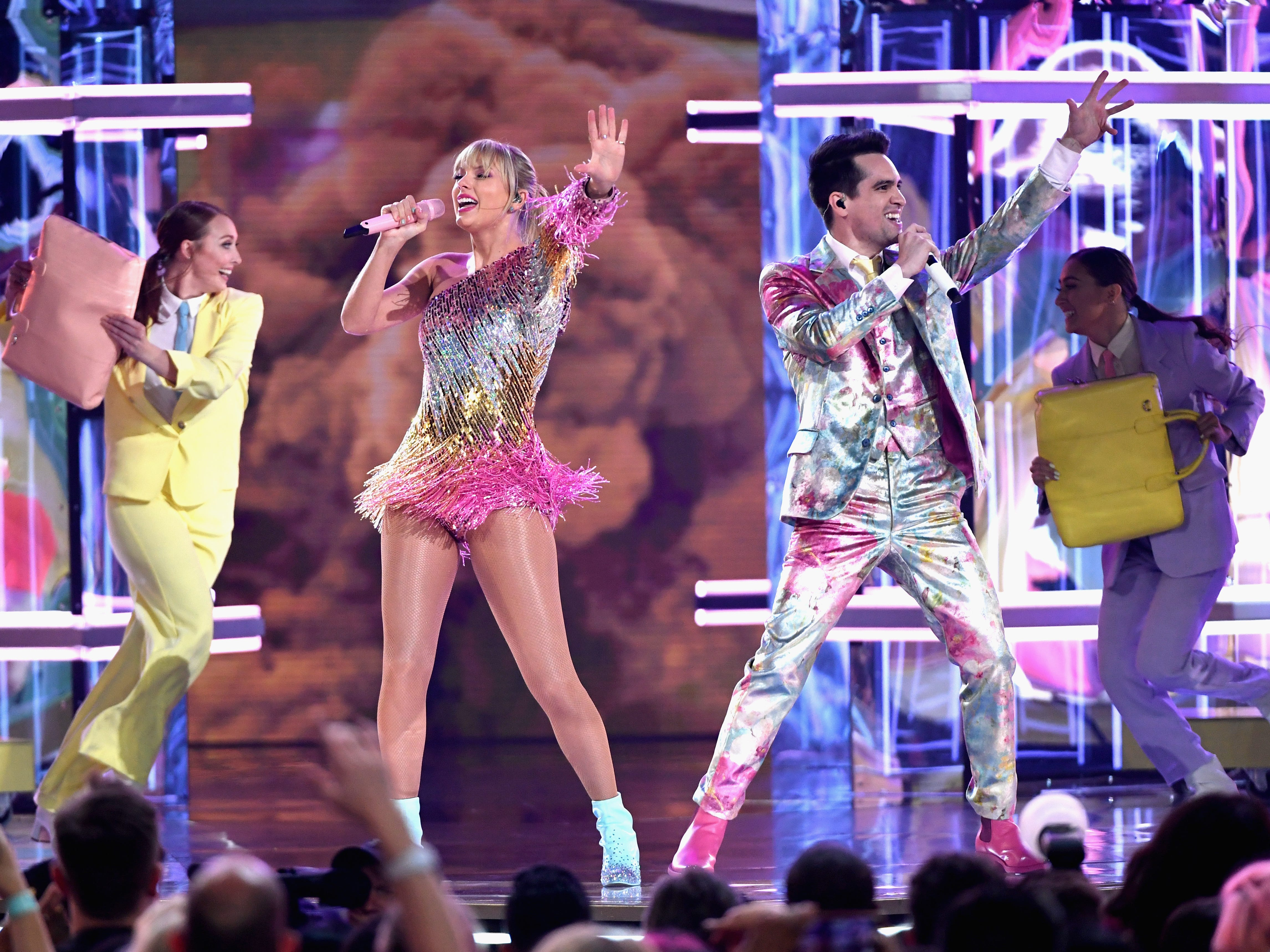 Taylor Swift performs with Brendon Urie of Panic! at the Disco onstage during the 2019 Billboard Music Awards at MGM Grand Garden Arena on May 1, 2019 in Las Vegas, Nevada.