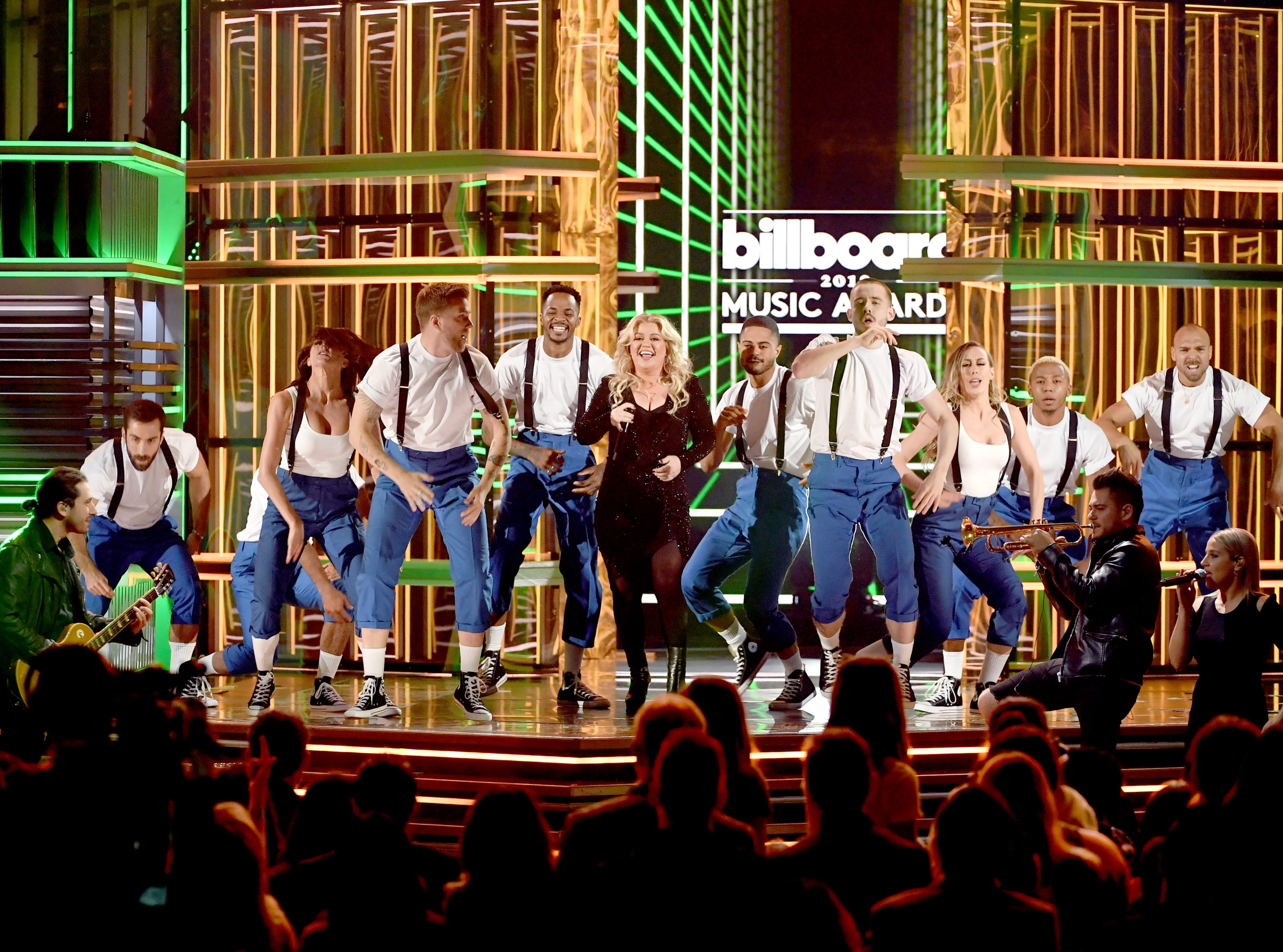Host Kelly Clarkson (sixth from L) performs onstage during the 2019 Billboard Music Awards at MGM Grand Garden Arena on May 01, 2019 in Las Vegas, Nevada.