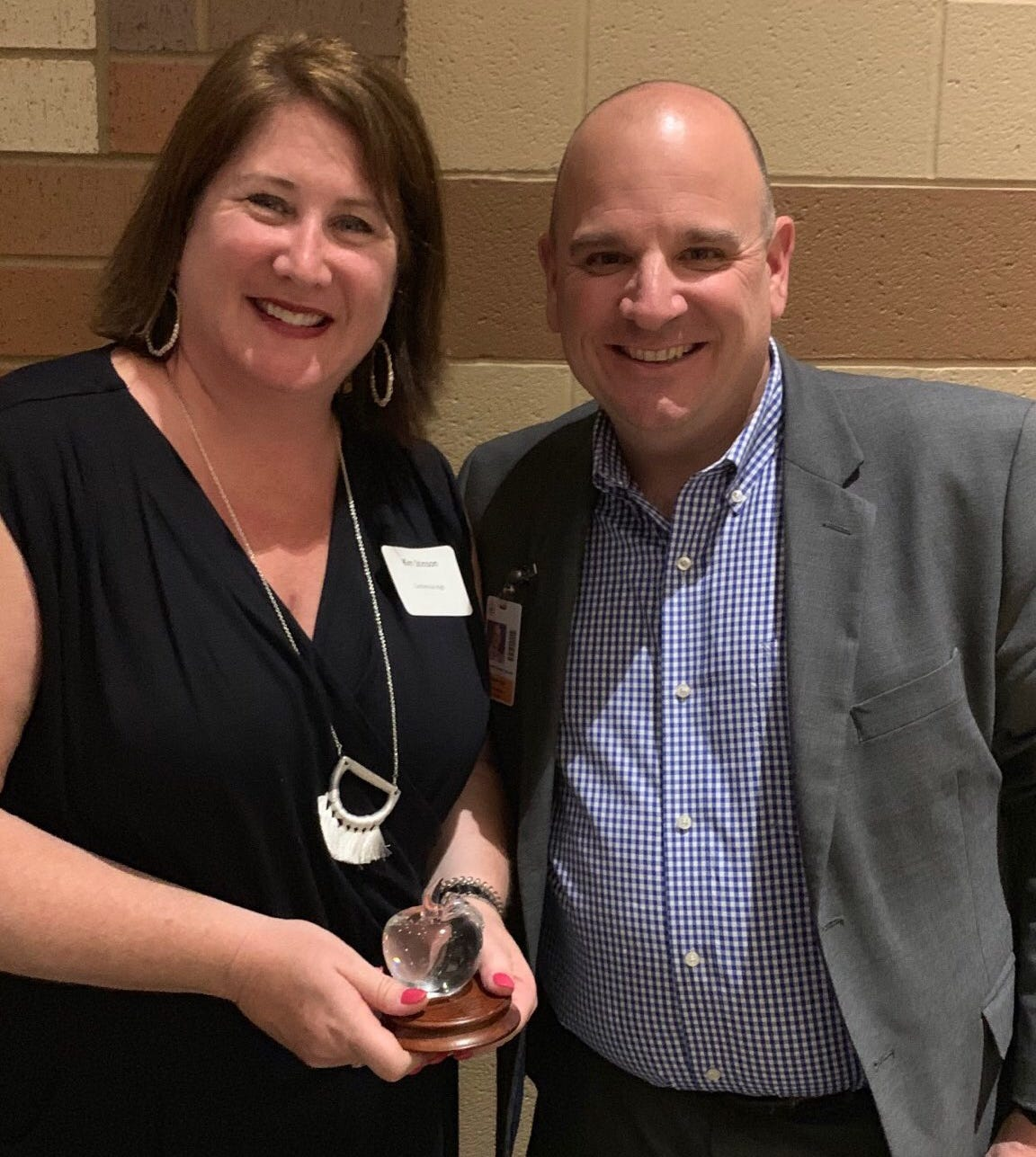 """Kim Stinson stands with Centennial High Principal Chris Hames after been named a WCS """"Shining Apple"""" for her volunteer work at CHS."""