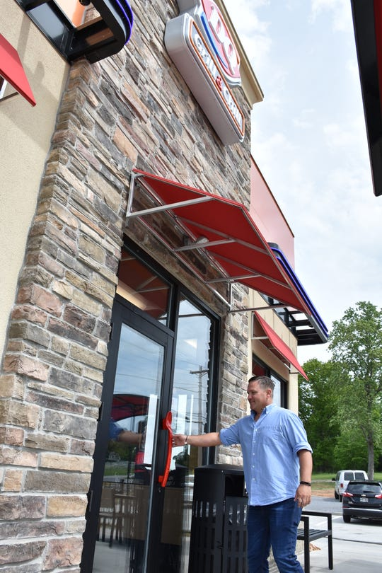 Franchisee Caleb Story steps Inside the new Dairy Queen in Charlotte he owns as preparations are made for the official Monday opening.