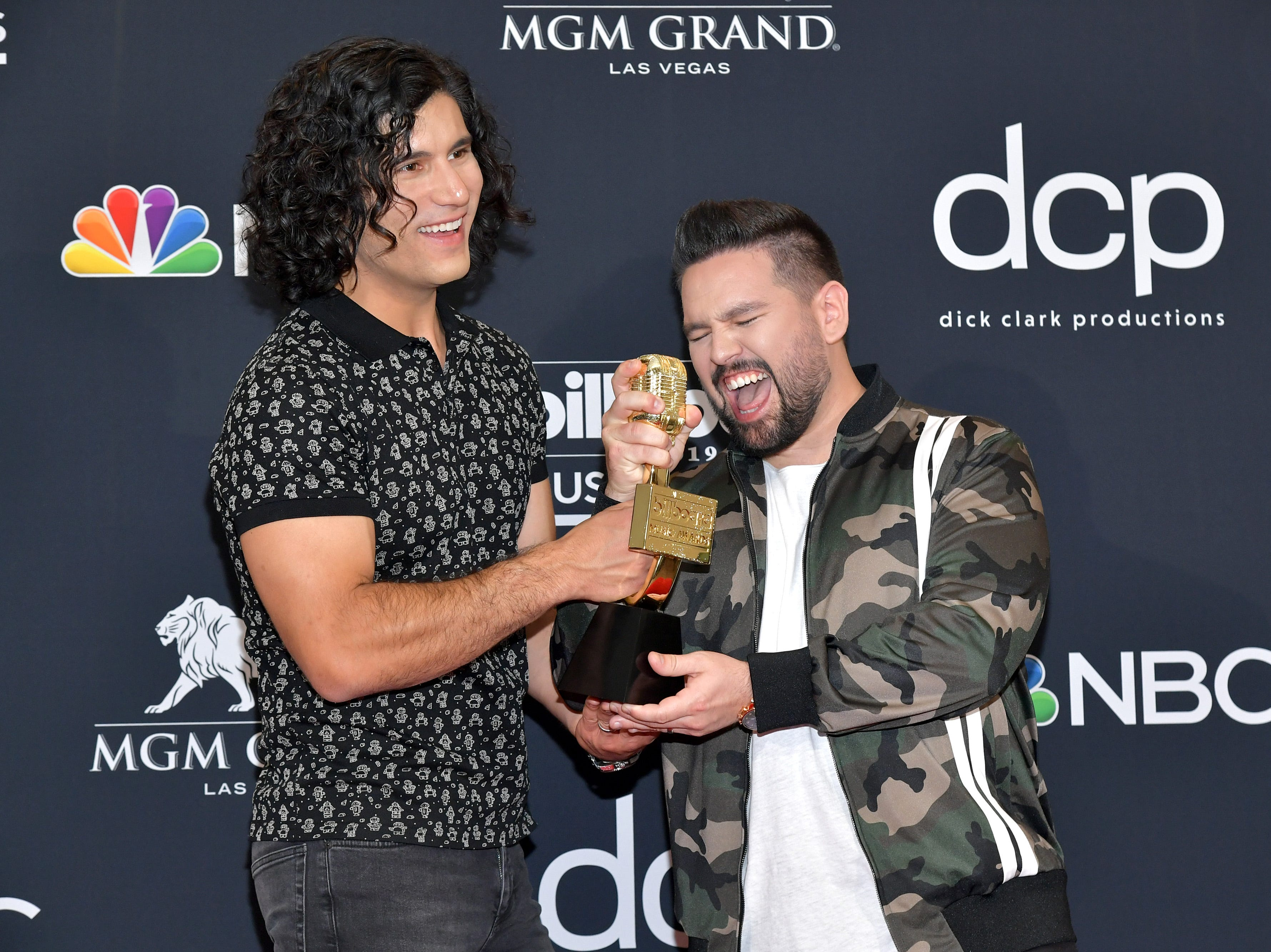 (L-R) Dan Smyers and Shay Mooney of Dan + Shay pose with the award for Top Country Duo/Group in the press room during the 2019 Billboard Music Awards at MGM Grand Garden Arena on May 01, 2019 in Las Vegas, Nevada.