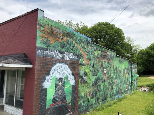 """A mural in the town square depicts Westmoreland's """"Little Tunnel,"""" built in 1886."""