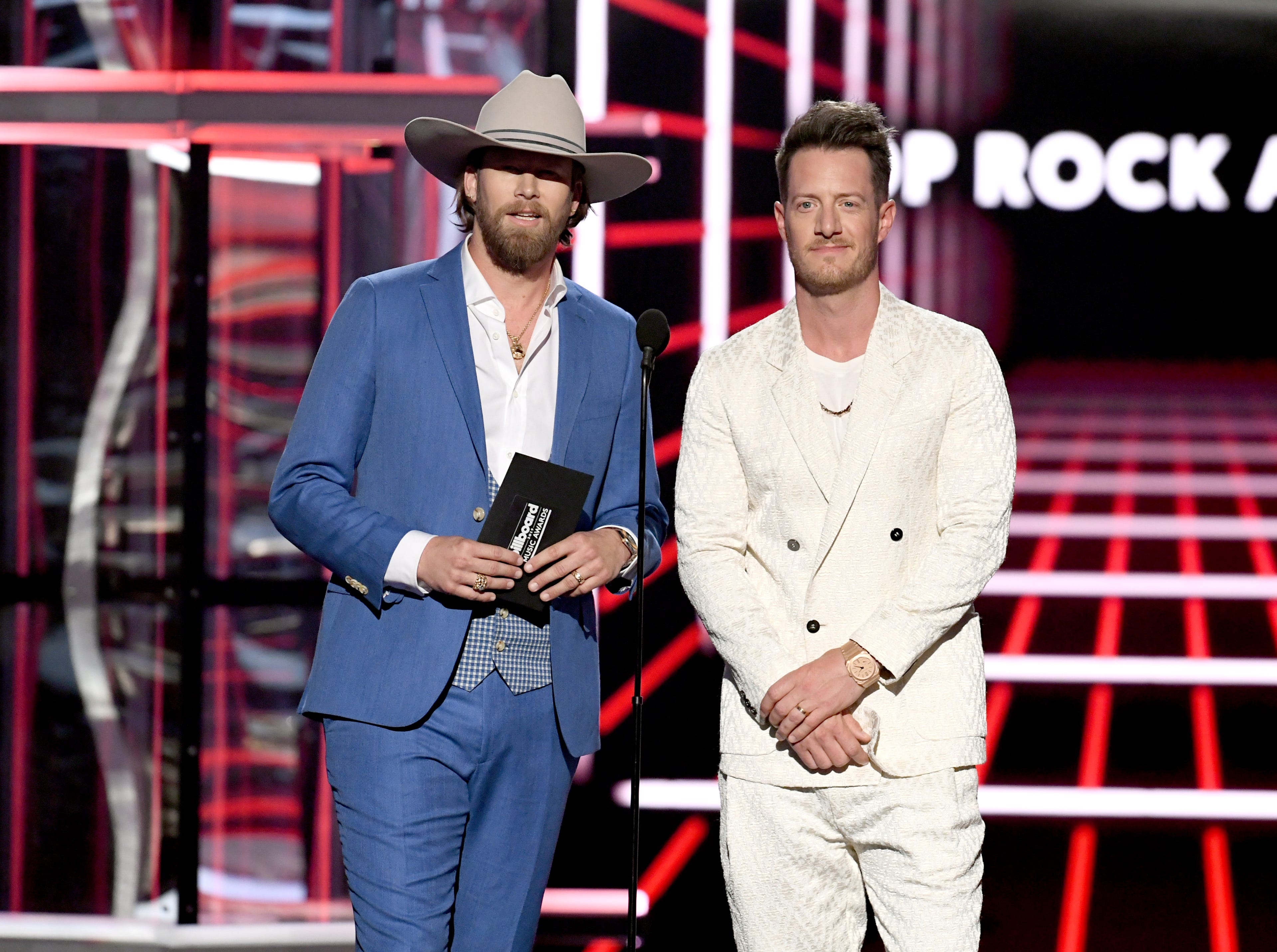 (L-R) Brian Kelley and Tyler Hubbard of Florida Georgia Line speak onstage during the 2019 Billboard Music Awards at MGM Grand Garden Arena on May 01, 2019 in Las Vegas, Nevada.