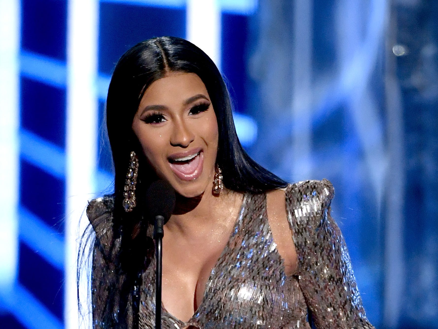 """Cardi B accepts Top Rap Song for """"I Like It"""" onstage during the 2019 Billboard Music Awards at MGM Grand Garden Arena on May 1, 2019 in Las Vegas, Nevada."""