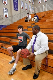 Father Ryan athletic director Devin DeLaughter talks with Luke Conger during basketball practice. Wednesday, May 1, 2019, in Nashville, Tenn.