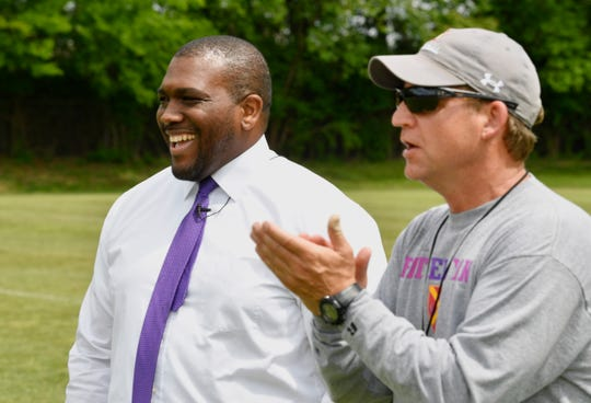 Father Ryan High School Athletic Director Dr. Devin DeLaughter -- the school's first African American administrator -- watches as Brian Rector coaches during football practice Wednesday, May 1, 2019, in Nashville, Tenn.