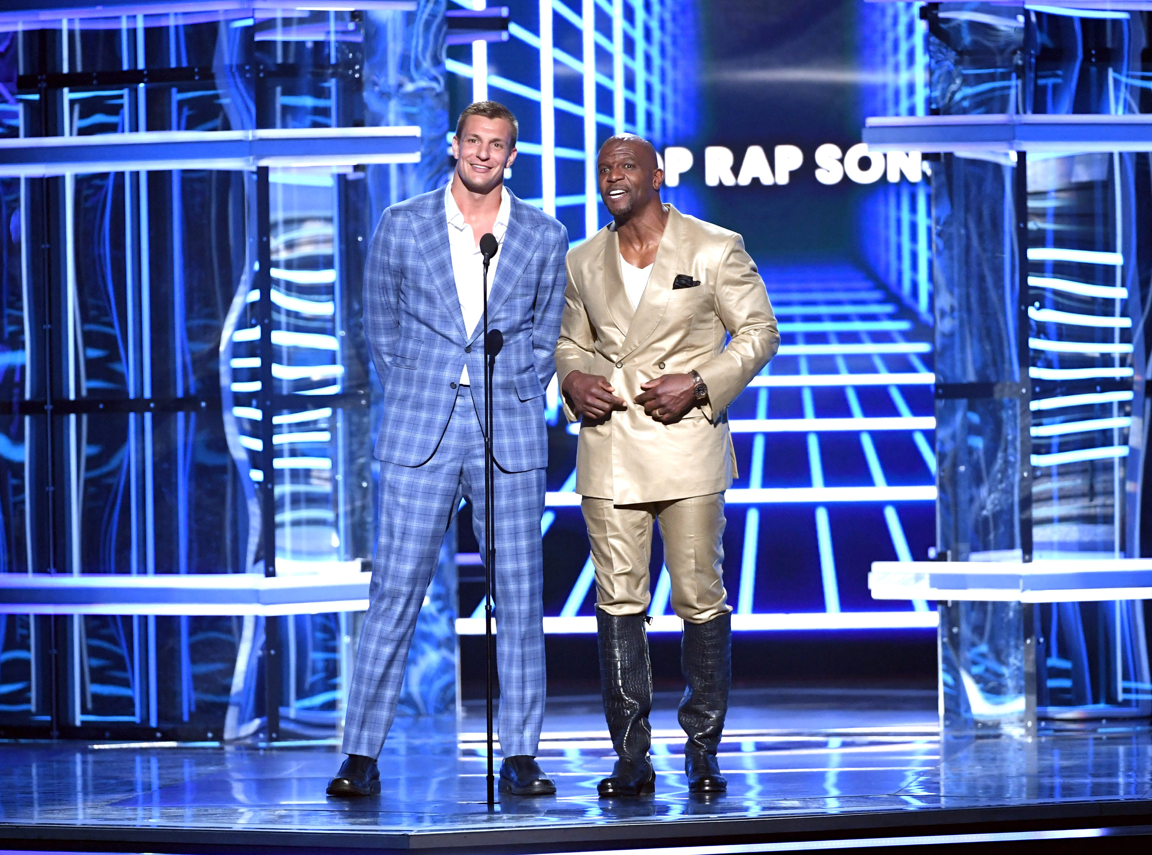 Rob Gronkowski and Terry Crews speak onstage during the 2019 Billboard Music Awards at MGM Grand Garden Arena on May 01, 2019 in Las Vegas, Nevada.