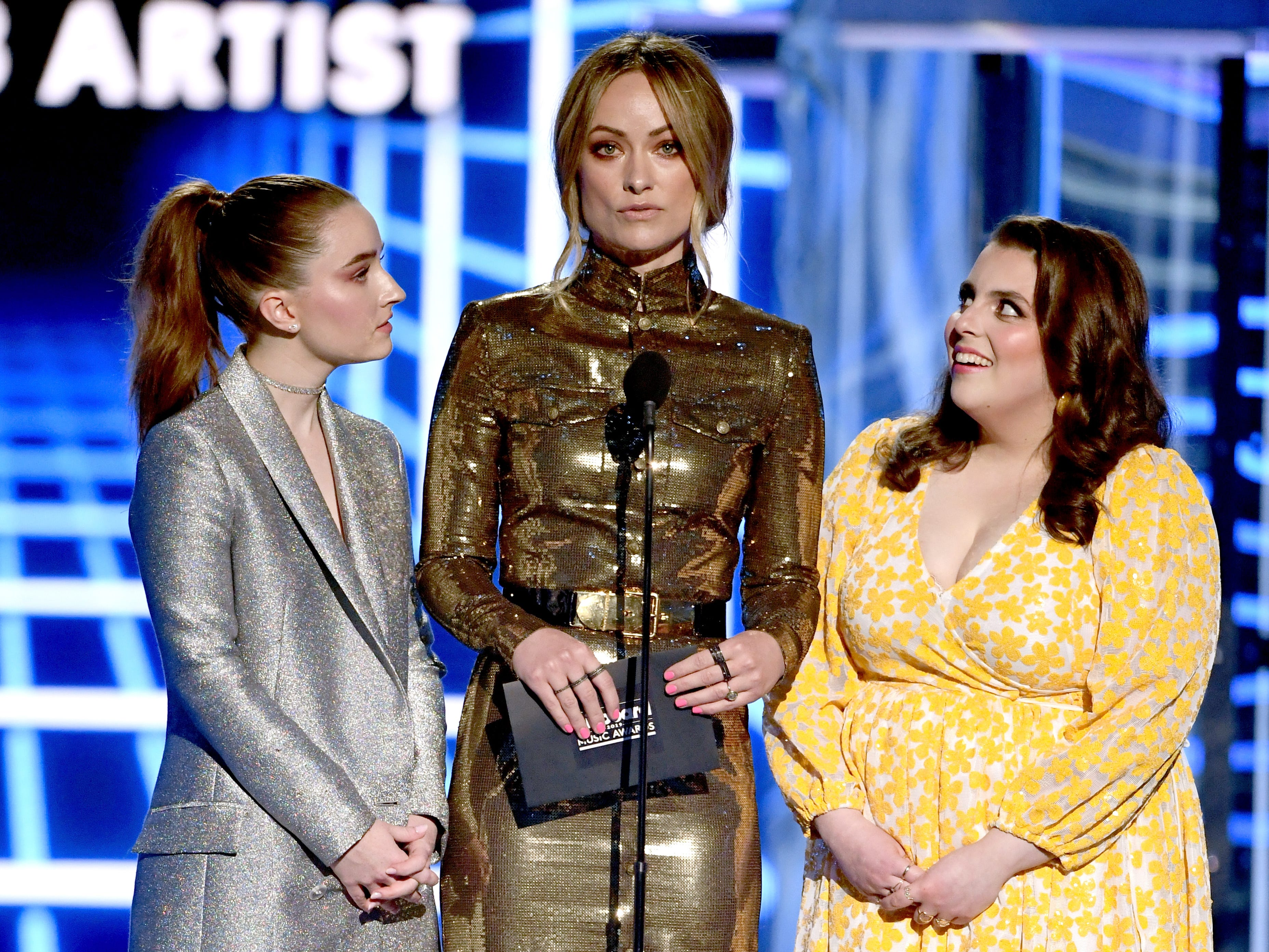 (L-R) Kaitlyn Dever, Olivia Wilde, and Beanie Feldstein speak onstage during the 2019 Billboard Music Awards at MGM Grand Garden Arena on May 1, 2019 in Las Vegas, Nevada.