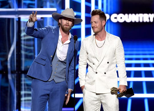 (L-R) Brian Kelley and Tyler Hubbard of Florida Georgia Line accept the Top Country Song award for 'Meant to Be' onstage during the 2019 Billboard Music Awards at MGM Grand Garden Arena on May 01, 2019 in Las Vegas, Nevada.