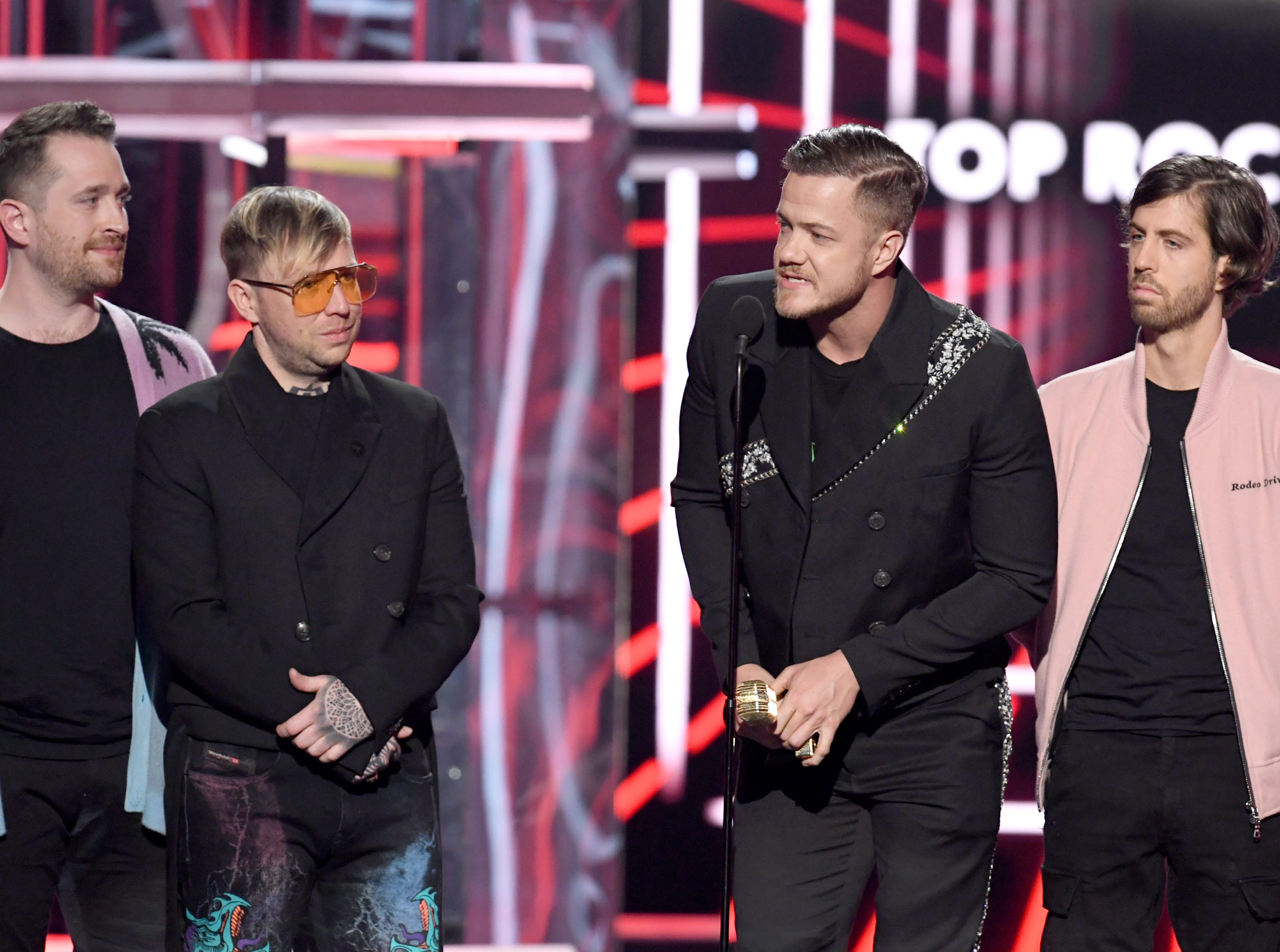 (L-R) Daniel Platzman, Ben McKee, Dan Reynolds, and Wayne Sermon of Imagine Dragons accept the Top Rock Artist award onstage during the 2019 Billboard Music Awards at MGM Grand Garden Arena on May 01, 2019 in Las Vegas, Nevada.