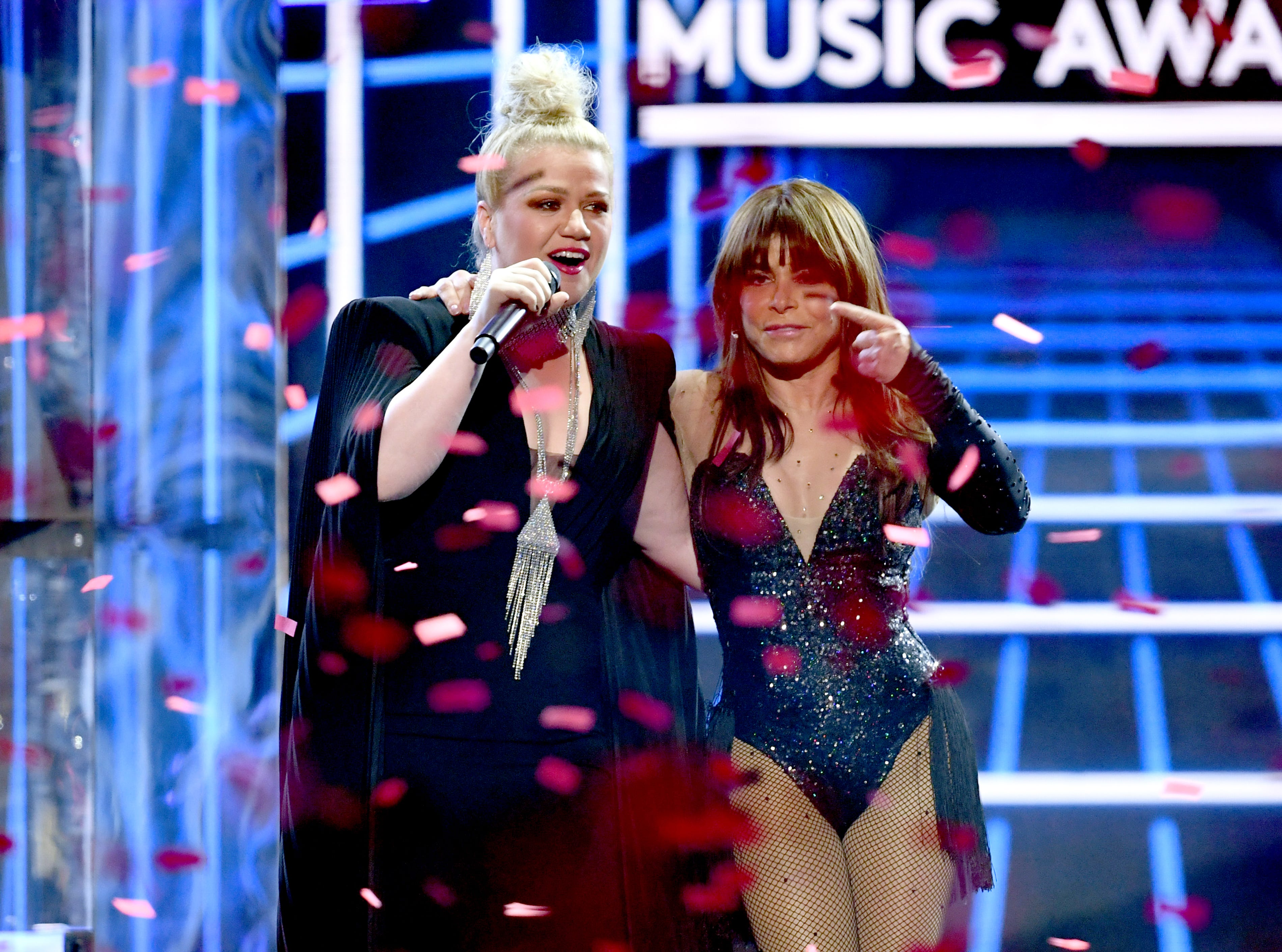 (L-R) Host Kelly Clarkson and Paula Abdul speak onstage during the 2019 Billboard Music Awards at MGM Grand Garden Arena on May 01, 2019 in Las Vegas, Nevada.