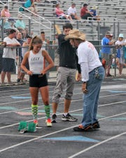 Lely's Laurin Hanscom listens to coach Mark McGarity at the Class 3A District Championship in 2013.