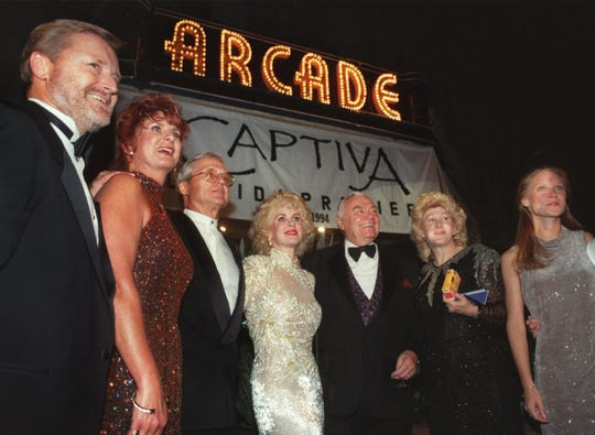 "Actor Ernest Borgnine, third from right, producer Paul Bush, third from left, and other VIPs line up in front of the Arcade Theatre in downtown Fort Myers before going in for the premiere of the movie ""Captiva Island"" in December 1994."