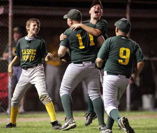 Classic Trophy players celebrate after beating Don Duvall Auctioneer 11-2 to win the Licking County Shrine Tournament Varsity Division title in 2008.