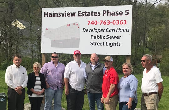Celebrating the groundbreaking of the fifth phase of Hainsview Estates are, from left: Licking County Commissioner Duane Flowers, village clerk-treasurer Nicole Gieseler, village council president Brandon Hale, developer Carl Haines, Hanover Mayor Jeff Collins, councilman Chris Felumlee, village zoning inspector Kim Christian, and village Public Affairs Board President Bill Fry.