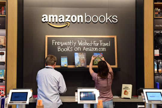 Employees set up books for display at the Amazon Books store at the Westfield Garden State Plaza in New Jersey. Amazon Books opened a store Nov. 22 at The Mall at Green Hills, marking the 21st location of the retail concept. It is the first Amazon Books outpost in Tennessee.