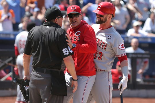 May 2, 2019; New York City, NY, USA; Cincinnati Reds manager David Bell (middle) is ejected after arguing with home plate umpire Marty Foster (60) after Cincinnati left fielder Jesse Winker (33) was also ejected during the ninth inning against the New York Mets at Citi Field.