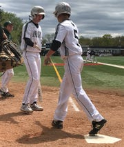 DePaul's Mikey Ramundo (21) congratulates EJ Wolf (5) after he crossed the plate in the Spartans' seven-run second inning on Saturday, April 27, 2019. DePaul defeated Eastern Christian, 11-1 in five innings, in the Passaic County baseball tournament first round.