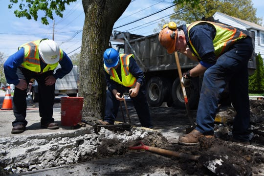 (From left) Jack McNaughton, Nino Manacchio and Luan Ahmetaj with Suez check water service lines, goosenecks and pipes on Edgewater Road in Cliffside Park on Thursday May 2, 2019.