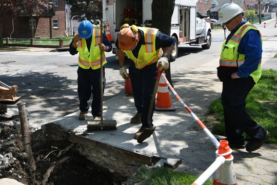 Nino Manacchio, Luan Ahmetaj and Jack McNaughton with Suez check water service lines, goosenecks and pipes on Edgewater Road in Cliffside Park on Thursday May 2, 2019.