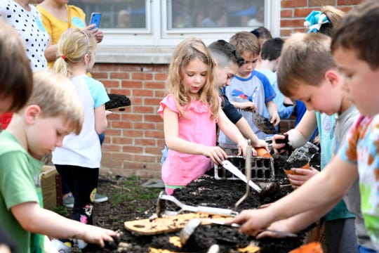 Sicomac Elementary School kindergartners play at the new mud table in their outdoor classroom on Thursday, May 2, 2019, in Wyckoff.