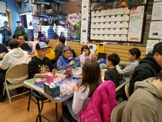 Ben Romeo, 9, of West Milford has a hood on as he competes in a Pokémon trading card game in Clifton.