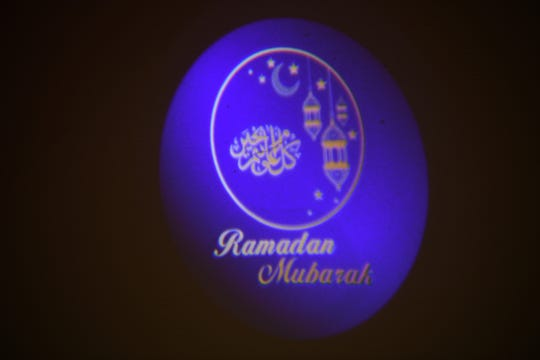 Yasmen Bagh has launched a company called Muslim Holiday Shop that sells outdoor decorations for the home to mark the Muslim holy month of Ramadan. One of Bagh's decorations, a projector, displays an image on Wednesday, May 1, 2019.