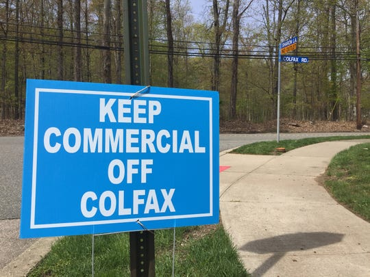 Opponents of a table tennis center, proposed to be built on a wooded tract on Colfax Road in Wayne, have planted lawn signs — like this one — throughout the township.