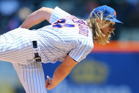 Noah Syndergaard of the New York Mets pitches in the second inning against the Cincinnati Reds at Citi Field   in New York City on May 2, 2019.
