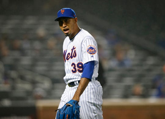 May 1, 2019; New York City, NY, USA; New York Mets relief pitcher Edwin Diaz (39) reacts after giving up a home run in the ninth inning against the Cincinnati Reds at Citi Field.
