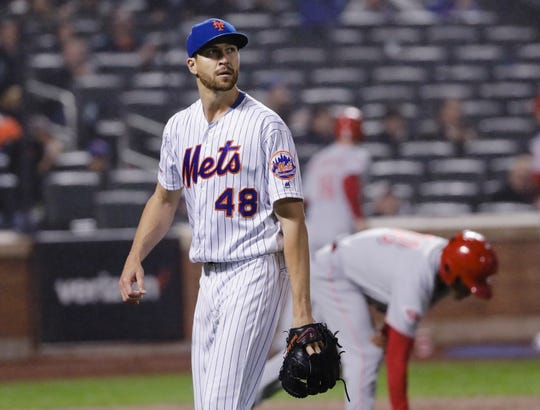 New York Mets starting pitcher Jacob deGrom leaves the field during the seventh inning of the team's game against the Cincinnati Reds on Wednesday, May 1, 2019, in New York. The Reds won 1-0.