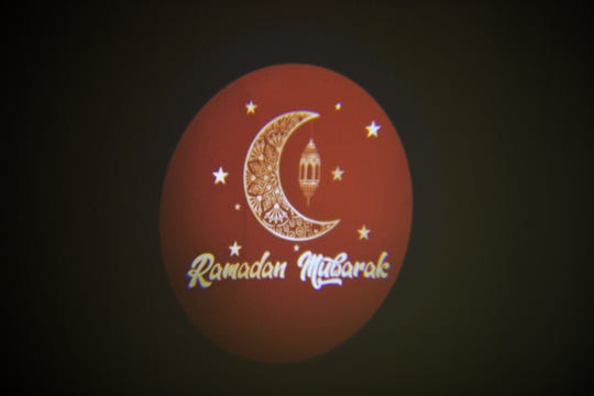 The Muslim Holiday Shop in Haledon, New Jersey, sells outdoor decorations for the home to mark the Muslim holy month of Ramadan. A projector is one of the decorations from Yasmen Bagh's company, which displays a Ramadan greeting Wednesday, May 1, 2019.