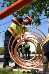 Jeffrey Scott with Suez holds copper pipe on Edgewater Road in Cliffside Park on Thursday May 2, 2019.