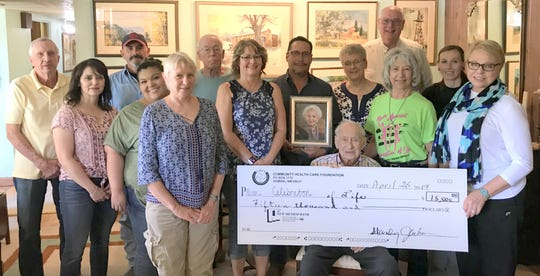 On behalf of the Cancer Support of Deming and Luna County Inc., the Celebration of Life cancer walk organizers accept a check in the amount of $15,000 from the Alma Feil Hospice Foundation and family members.