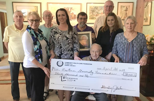 The Western New Mexico University Foundation was presented a check for $30,000.