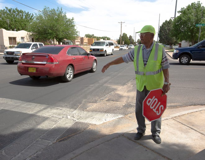 Valley View Elementary School crossing guard Stan Infante, directs traffic, Thursday, May 2, 2019, at Valley View Elementary School. The crossing guard, who celebrated his 99th birthday on April 25, said he continues to do this job, because he loves the children.