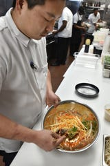 "Grant Vella, also known as ""Chef G"" whips up a papaya and greens salad on May 2."