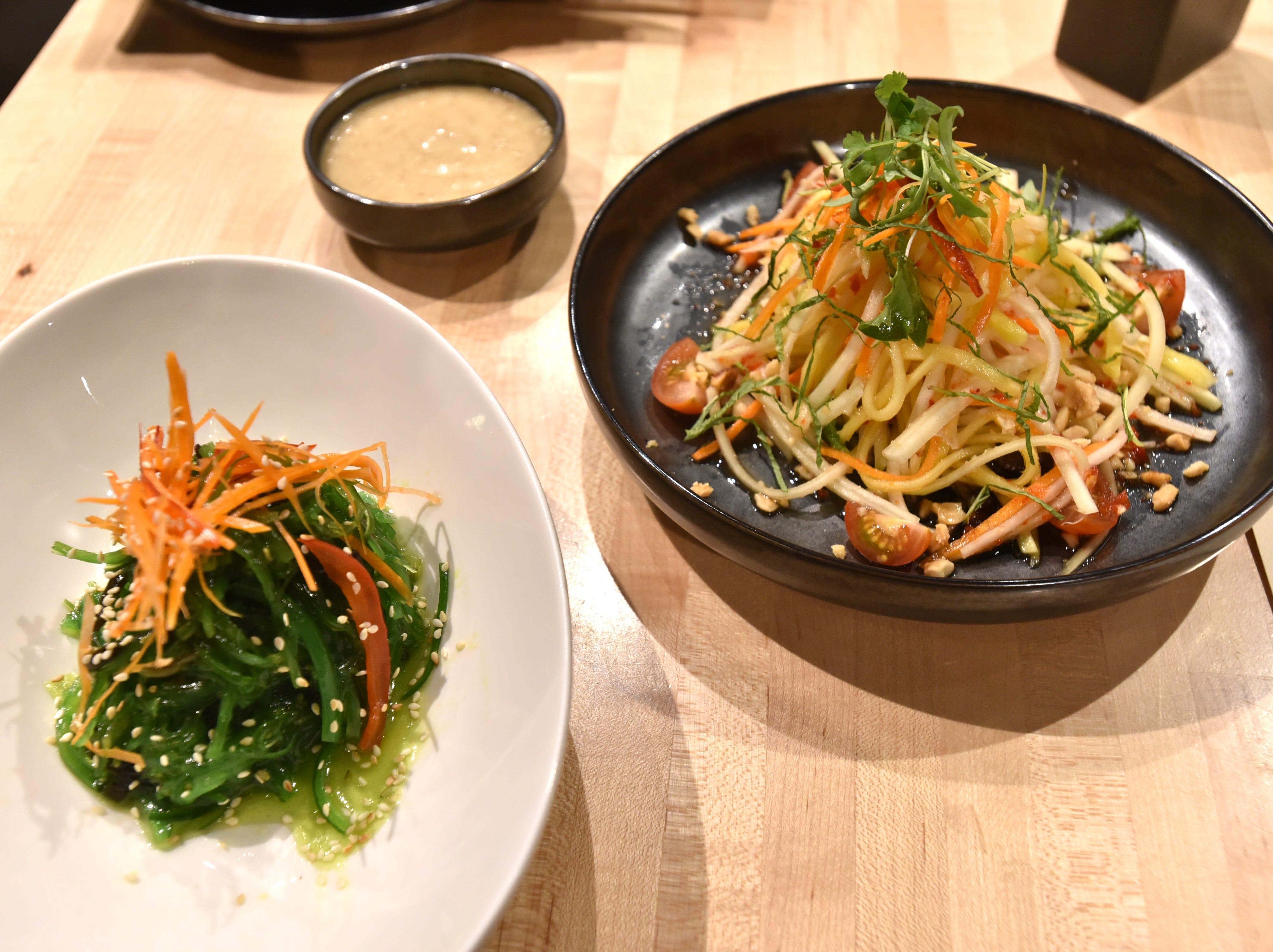 A seaweed and papaya and greens salad from Bloomfield's Jao Jun.