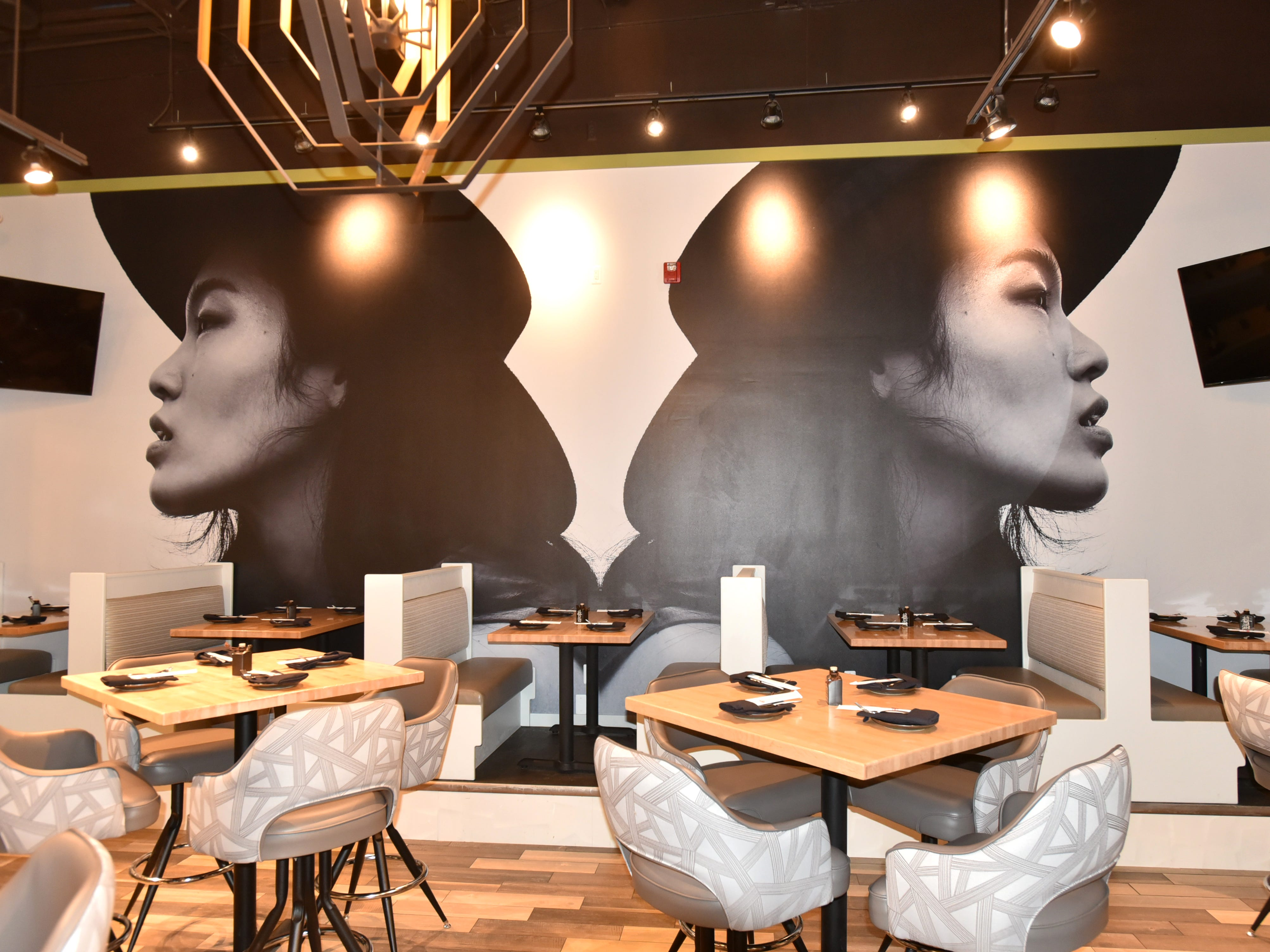 The interior of Bloomfield's Zao Jun features lots of wood and metal accents and large, wall-sized photos.