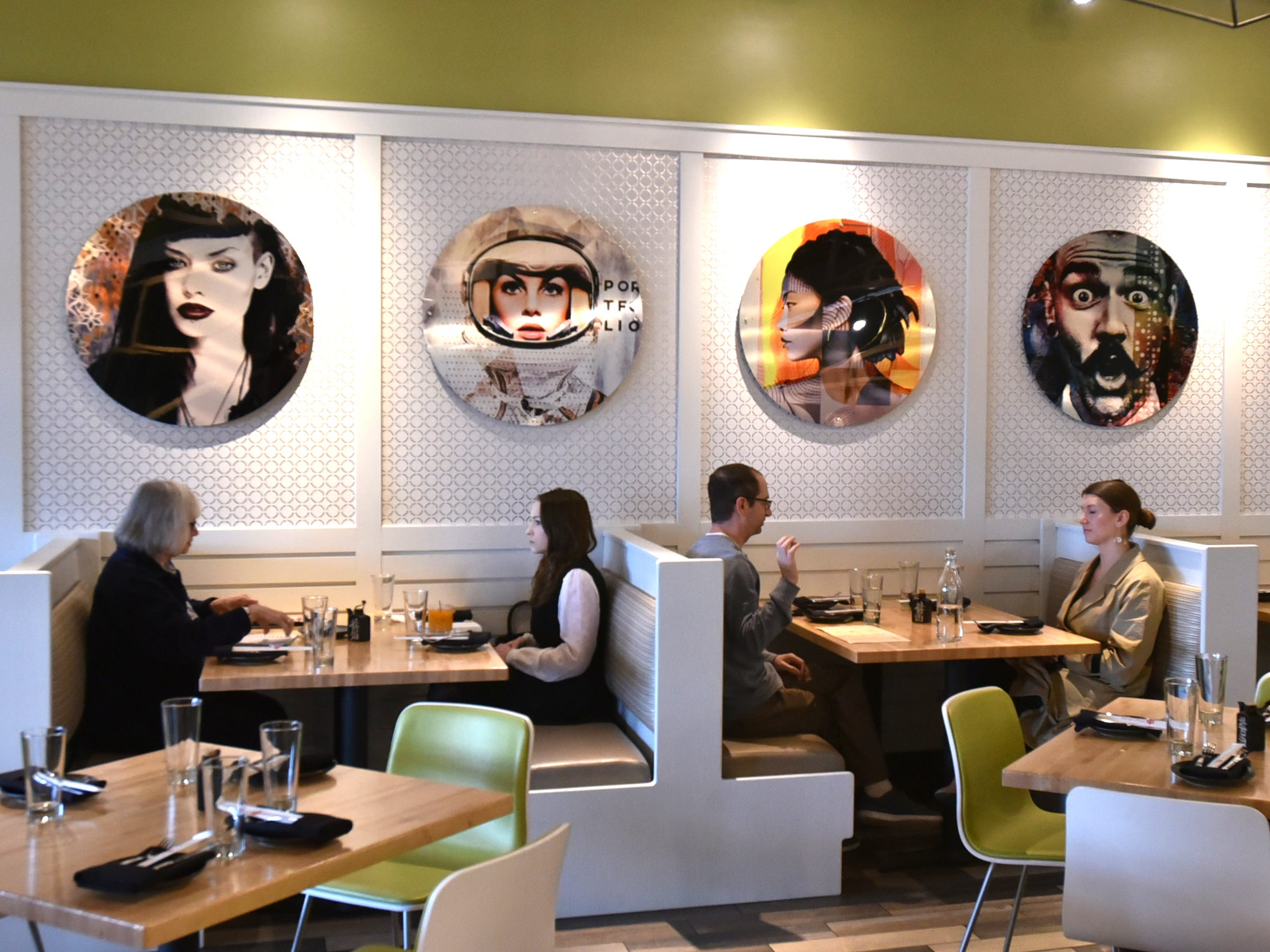 A quartet of lunch-time diners check out the fare at Zao Jun on May 2.