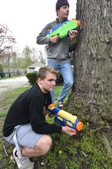 Water gun warriors Ben Wright and Noah VanBerkle (top) gather at VanBerkel's home in Plymouth. The teammates begin some of their Water War patrols as early as 5 a.m.