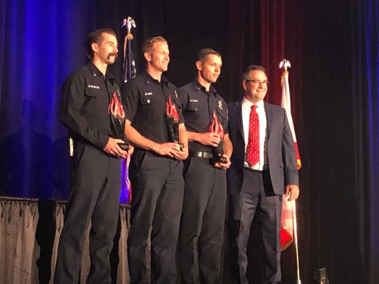 Palm Springs Firefighter Dan Rowles, Engineer McClain Berg and Capt. Matt Kearney pose with Fire Chief Kevin Nadler at the Police and Fire Appreciation Luncheon on May 2, 2019.