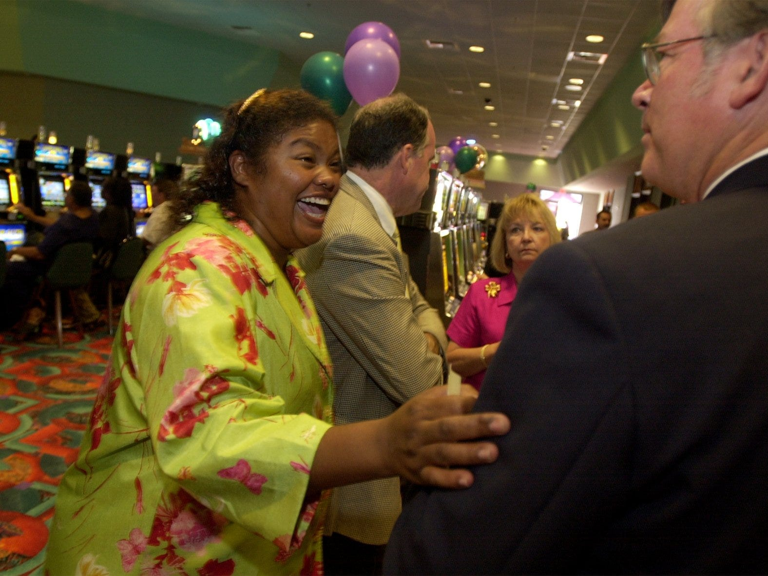 In this 2002 photo, Augustine Band of Cahuilla Indians chair Mary Ann Martin , left, smiles as she chats with Bruce Kupcha  during a private party at the then-new Augustine Casino in Coachella prior to opening to the public.