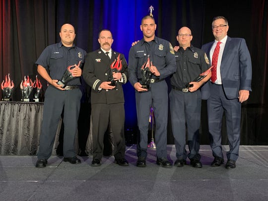 Engineer Franco Pineda, Capt. Greg Lyle, Capt. Wayne Seacrist and Capt. Matt MacLean pose with Palm Springs Fire Chief Kevin Nadler after receiving awards at the luncheon.